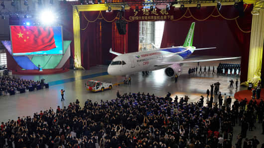 China's first self-developed large passenger jetliner C919 is presented after it rolled off the production line at Shanghai Aircraft Manufacturing Co., Ltd on November 2, 2015 in Shanghai, China